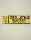 Altes Kipper-Häuschenzeichen Lizenzfreies Stockbild