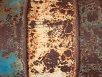 Altes Metall malte ein rostiges Faß. Hintergrund. Lizenzfreie Stockfotos
