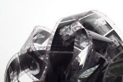 Altes Negativ 35 Millimeter-Filmstreifen auf weißem Hintergrund Stockfotografie