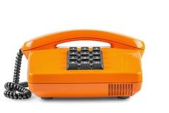 Altes orange Telefon mit Schatten auf weißem Hintergrund Stockbild