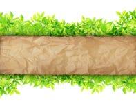 Altes Papier auf grünen Blättern Stockfoto