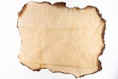 Altes Papier auf weißem Hintergrund Stockfotografie