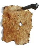 Altes Papier oben angeheftet mit Messer Stockfotografie