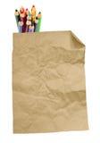 Altes Papierblatt und Stapel farbige Bleistifte Stockbild