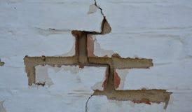 Altes Rot gemalte Backsteinmauer Stockbild