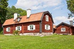 Altes rotes Haus. Lizenzfreies Stockfoto
