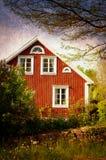 Altes rotes Holzhaus, Schweden stockbild