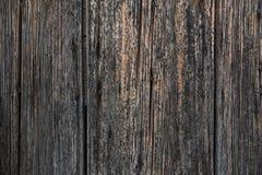 Altes Schwarzes brannte Wand, Zaun als Hintergrund oder Tapete lizenzfreies stockbild