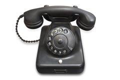Altes schwarzes Telefon Stockbilder