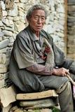 Altes tibetanisches Mannporträt Stockfotografie