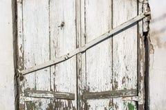 Altes verschaltes-oben Fenster auf Backsteinmauer Stockfotografie