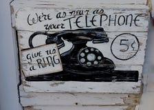Altes Zeichen des Telefons Stockbild