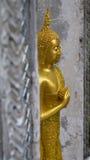 Altezza di Buddha per la persona che sopportata in venerdì Fotografia Stock