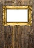 Altgold-Bilderrahmen auf hölzernem Hintergrund Lizenzfreie Stockbilder