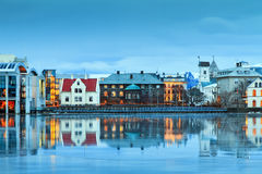 Althing reflection. Beautiful reflection of the parliament house Althing of Reykjavik in lake Tjornin at the blue hour in winter Stock Photos