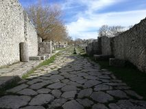 Altilia - Decumanus from Porta Bojano. Altilia, Sepino, Campobasso, Molise, Italy - 8 March 2018: The decumanus of the small Roman city of Samnite origins arose royalty free stock image