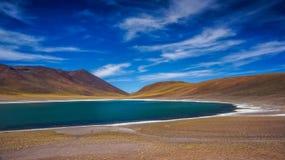 Altiplanic lagoon in Atacama. Desert between mountains royalty free stock photography