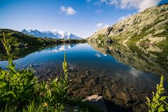 Altitude Lake Reflecting Iconic Mont-Blanc Mountain Range on a S. Unny Summer Day Royalty Free Stock Photo