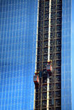 Alto, blu, fatto da costruzione di vetro Fotografie Stock