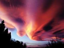 Alto Cummulus Lenticularis. Foehn cloud over Basel during sunset stock photos