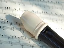Alto recorder. Alto flute (recorder) on the notes sheet - scores with shadow stock photography