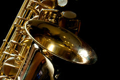 Alto saxophone. With little dust for background Royalty Free Stock Photography