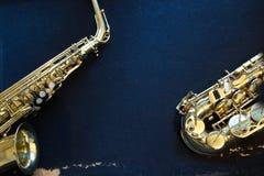 Alto saxophone. On a blue background royalty free stock photo