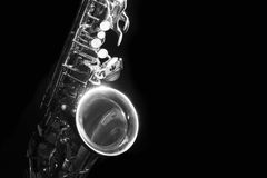 Alto saxophone in the dark black and white. Low key alto saxophone and light in the dark background Royalty Free Stock Photo