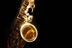 Alto saxophone in the dark. Low key alto saxophone and light in the dark background Stock Images