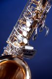 Alto Saxophone Isolated on Blue Royalty Free Stock Photo