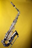 Alto Saxophone Isolated on Yellow Stock Photos