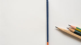 Alto vicino e taccuino della matita Immagine Stock