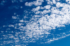 Altocumulus clouds in blue sky on sunny peaceful day Stock Photography