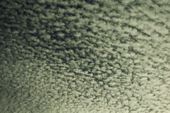 Altocumulus. Clouds hanging over the island of Tenerife Royalty Free Stock Image
