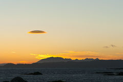 Altocumulus lenticularis cloud at sunset Stock Images