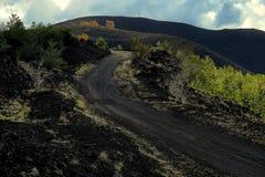 Altomontana path crosses 1832 lava field of Nunziata Mount in Etna Park stock photography