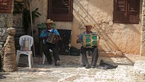 ALTOS DE CHAVON, DOMINICAN REPUBLIC, DECEMBER 21, 2012: Musicians playing national music stock footage