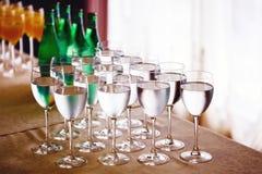 Altos vidrios con agua o el vino Imágenes de archivo libres de regalías