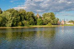 Altufevsky Pond in a recreation area in Altufevo, Moscow. MOSCOW, RUSSIA - 23 JULY, 2017: Altufyevo Manor and Church of the Exaltation of the Holy Cross Royalty Free Stock Photo