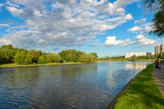Altufevsky Pond in a walking area. MOSCOW, RUSSIA - 23 JULY, 2017: Altufevsky Pond in a walking area on a warm summer evening in a recreation area in Altufevo Royalty Free Stock Photos
