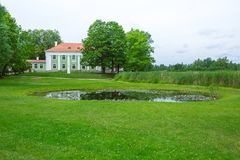 Aluksne, old hause in Latvia. Nature and fresh air. stock photo