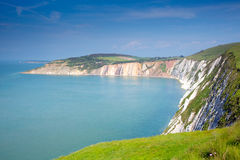 Alum Bay Isle of Wight next to the Needles tourist attraction. Alum Bay Isle of Wight beautiful beach and rocks next to the Needles tourist attraction Royalty Free Stock Photo