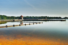 Alum Lake 'Kamencove jezero' in Chomutov city with wooden pier at the end of the summer tourist season Stock Photography