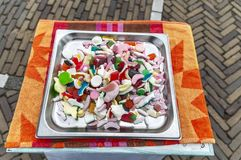 metal tray on a table filled with various candy royalty free stock image