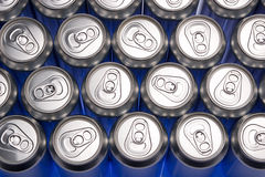 Aluminium cans. Top view of aluminium cans over bluish background royalty free stock image