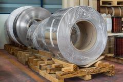 Aluminium coils. Aluminium rolled products or aluminium coils in storage area, conductor raw material stock images
