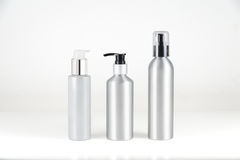 Aluminium cosmetic dispenser bottles and cartridges Royalty Free Stock Photos