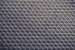 Aluminium dark list with rhombus shapes Royalty Free Stock Photos