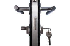 Aluminium door handle. Aluminium door knob on the black door white background Royalty Free Stock Photo