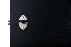 Aluminium door handle. Aluminium door knob on the black door white background Royalty Free Stock Photos
